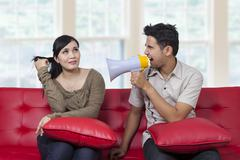 Man uses megaphone to bully his girlfriend Stock Photos