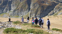 Stock Video Footage of People group walking in picturesque Bulgarian mountains in Rila Nature Park