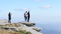 Stock Video Footage of A photo for couple on a top of rock mountain in Bulgaria Rila Lakes Nature Park