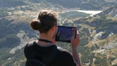 Stock Video Footage of Guy make photo of picturesque view in mountains via tablet computer camera
