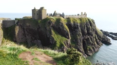 Dunnottar Castle with blue sky in - Stonehaven, Aberdeen, Scotland UK Stock Footage