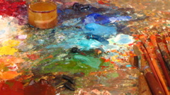 Art palette with paints and brushes - stock footage