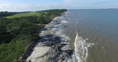Stock Video Footage of Jekyll Island Driftwood Beach Aerial Dolly Out