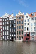 Stock Photo of Amsterdam city with historic houses along Canals