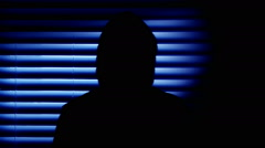 Hooded man moving in the shadows Stock Footage