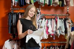 Young mom shopping - stock photo