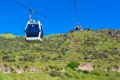 Funicular on green valley Stock Photos