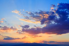 Sky with clouds at sunset natural background - stock photo