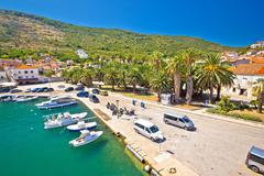 Emerald sea and palm waterfront of Vis - stock photo