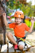 Young boy playing and having fun doing activities outdoors. Happy childhood Stock Photos
