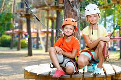 Young boy and girl playing when having fun doing activities outdoors. Happy Stock Photos