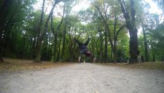 Young man dancing breakdance in the parks Stock Footage