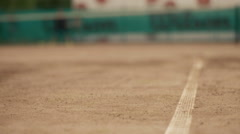 Tennis ball on the court and in the background grid Stock Footage