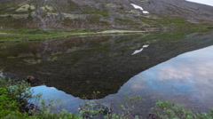 Mountain lake landscape with reflection of snow tops on water surface. Khibins Stock Footage