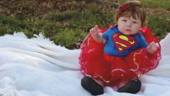 Baby girl in supergirl outfit and tutu Stock Footage