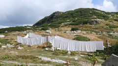 Pure white linens - sheets and duvet covers - dried in the mountains in open air Stock Footage