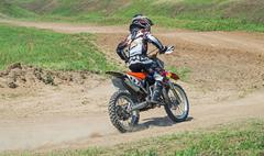 Youthful racer motorcycle - stock photo