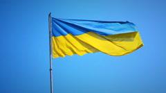 Ukrainian national flag against the blue sky Stock Footage