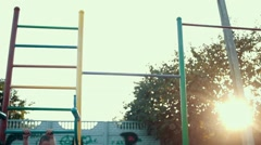 Stock Video Footage of Little girl pulls on the bar. The concept of children's sports