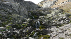 Mountain melt pure water flowing down the rocks in Bulgaria Rila Lakes park Stock Footage