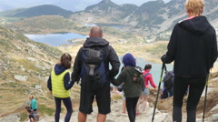 Stock Video Footage of People hiking in picturesque Bulgarian mountains in Rila Lakes Nature Park