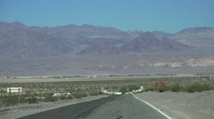 Stovepipe Wells HIGHWAY, driving by desert mountains Stock Footage
