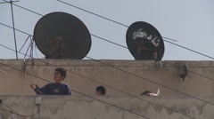 Kite flying by refugee children on rooftops, multiple perspectives Stock Footage