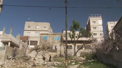 Missing house in refugee area in Amman, Jordan, wide with kite in background Stock Footage