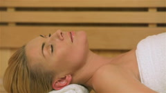 Woman relaxing at the sauna - stock footage