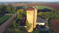 Scenic Aerial Flyover of Abandoned Rural Farm Silos Stock Footage