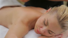 Woman on spa massage of shoulder - stock footage