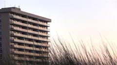 Establishing shot of ocean side apartment complex at sunset 4k Stock Footage
