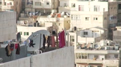 Washing on balcony in Amman, Jordan, cityscape telephoto Stock Footage