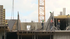 Workers at the construction site. - stock footage