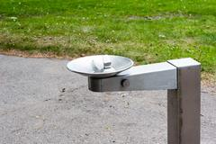 Stock Photo of Metal drinking fountain in park