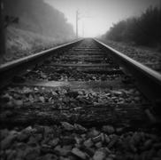 Railway tracks vanishing into the distance - stock photo