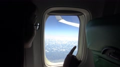 4K Asia Young beautiful girl look out of airplane window during plane flight-Dan Stock Footage