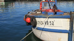 Rustic Fishing Boat docked in Harbour Stock Footage