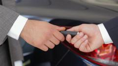 Salesman giving the key of the new car Stock Footage