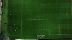 Aerial flying with drone by soot in and over  of theToumba Stadium full of fans  Stock Footage