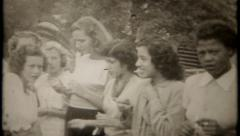 2552 - college girls, blowing balloons, play games - vintage film home movie Stock Footage