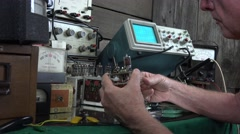 Home inventor , vacuum tube on circuit board Stock Footage