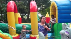 Chinese children are playing in the playground. Stock Footage