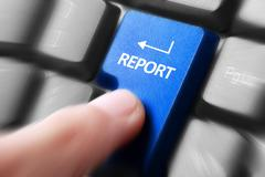 Stock Photo of hand press report button on keyboard