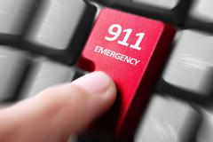 hand press 911 button on keyboard - stock photo