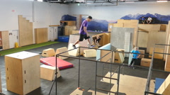 Young Adult Doing Various Parkour Movements Stock Footage