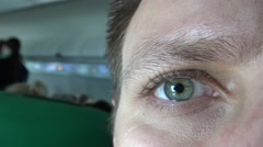 Green Eye Opens, Detail Pupil Dilates Man caucasian ethnicity in airplane 4K-Dan - stock footage