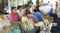 Short Term Missions Team Praying For Elderly People In Asia Stock Footage
