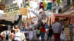 Crowd people walking through a market medieval Moorish in Spain Stock Footage