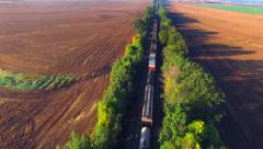 Train rolls through rural countryside at sunrise, wonderful light effects - stock footage